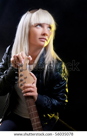 Pretty blond girl playing  electric guitar - stock photo