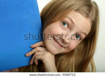 Pretty blond girl with copy space blue book - stock photo