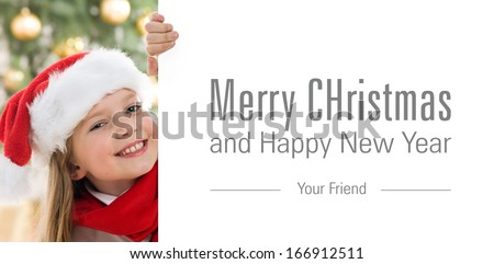 Pretty blond hair girl with santa hat and red comforter holding white board with space for text isolated on white. Christmas tree in background  - stock photo
