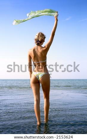 pretty blond in bikini with green scarf in water - stock photo
