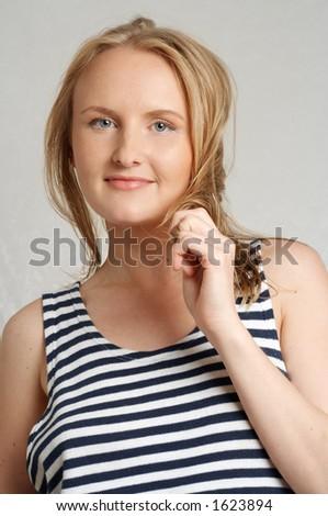 pretty blond in sailor's striped vest - stock photo
