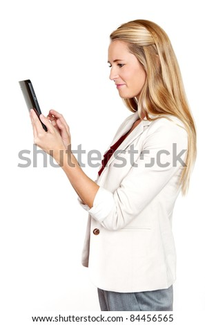 Pretty blond professional woman using her touch screen pad