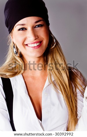 pretty blond smiling woman studio shot - stock photo
