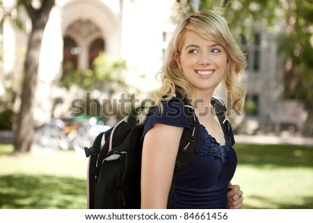 Pretty blond university student looking over shoulder