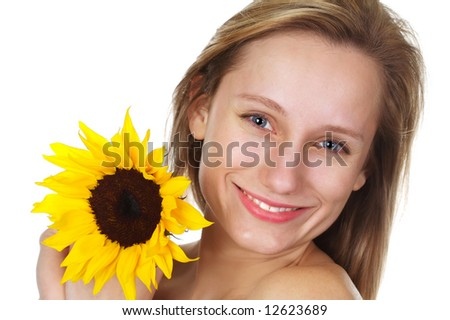 Pretty blond with a smile holding a bright yellow sunflower