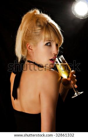 pretty blond woman drinking champagne - stock photo