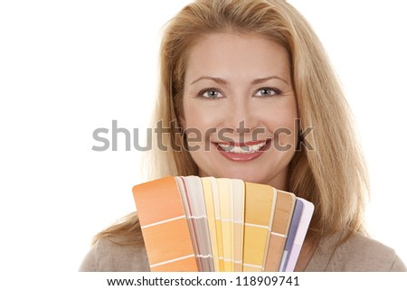 pretty blond woman holding color chart on white isolated background - stock photo