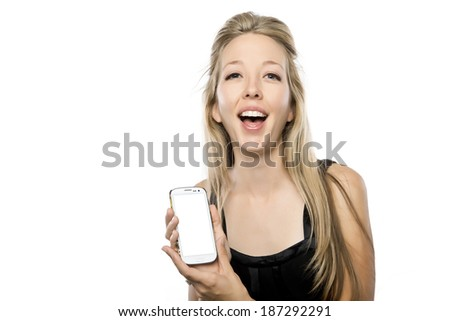 Pretty blond woman holding her phone with an excited expression, screen is blank ad your own image - stock photo