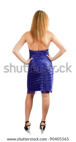 Pretty blond woman on white backdrop standing back - stock photo