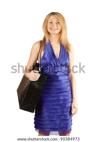 Pretty blond woman on white backdrop with black bag - stock photo