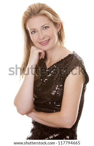 pretty blond woman wearing brown top sitting on white background - stock photo