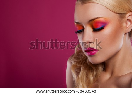 pretty blond woman with bright creative make up