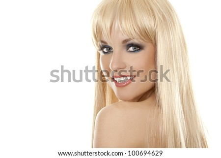 pretty blond woman with colorful makeup on white background - stock photo