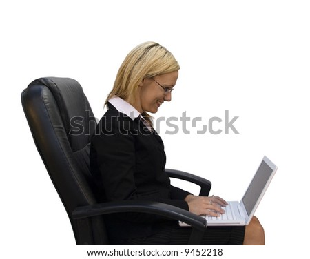 Pretty blonde businesswoman on laptop computer and leather chair isolated on white background.