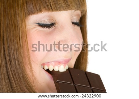 Pretty blonde eating chocolate, isolated on white background