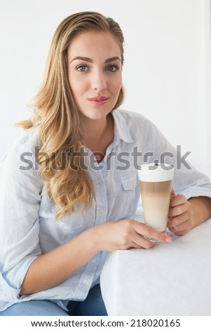 Pretty blonde enjoying a latte at the coffee shop