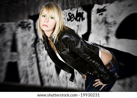 Pretty Blonde Girl against Graffiti Background - stock photo