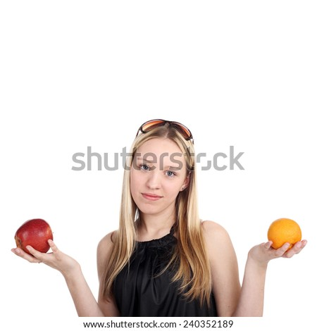 pretty blonde girl holding an apple and orange in her hands