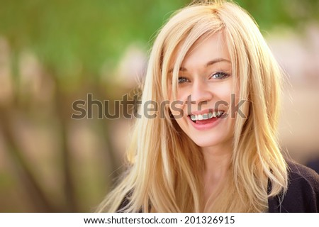 Pretty blonde girl laughing. - stock photo