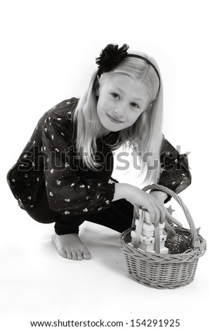 pretty blonde girl with basket, carrying Christmas presents, isolated on white in monochrome