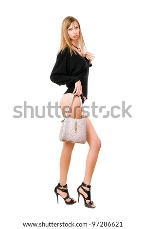Pretty blonde girl with the white purse - stock photo