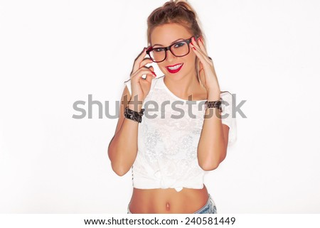 Pretty blonde hipster girl in glasses with red lips posing on white background and have fun  - stock photo