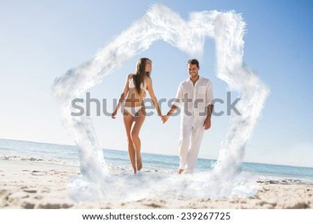Pretty blonde holding hands with handsome boyfriend against house outline in clouds - stock photo