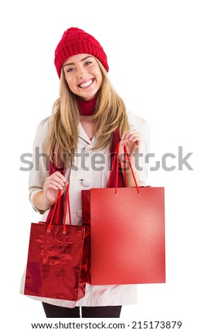 Pretty blonde holding shopping bags on white background
