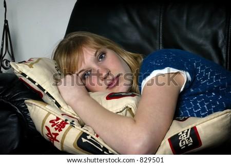 pretty blonde laying on sofa - stock photo