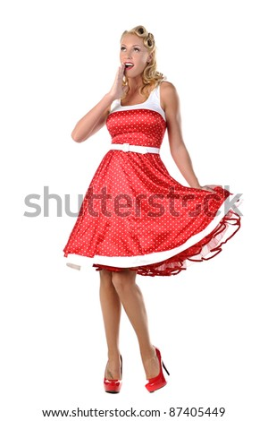 pretty blonde pinup model in a red and white polkadot dress - stock photo