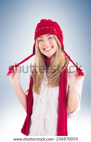 Pretty blonde smiling at camera in warm clothes on vignette background