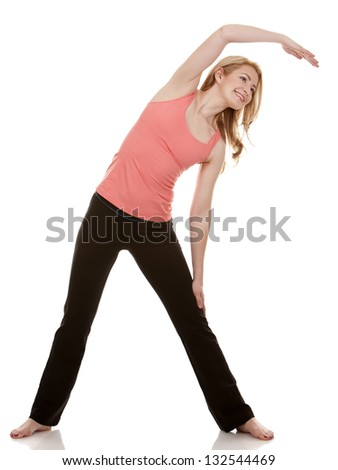 pretty blonde wearing active wear on white background - stock photo