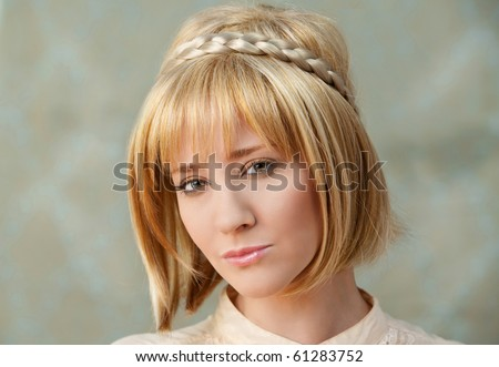 Pretty Blonde With Hair Braid - stock photo
