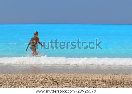 Pretty blonde woman enjoying the Ionian sea in Greece - stock photo