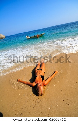 Pretty blonde woman enjoying the Ionian sea in Greece