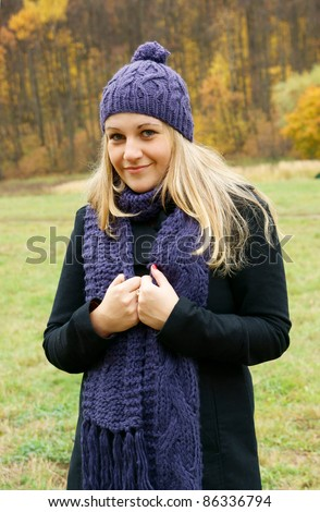 Pretty blonde woman in autumn park