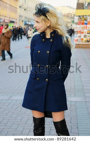 Pretty blonde woman in the street