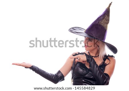 Pretty blonde woman in the witch costume with her hand up, place your product here  - stock photo