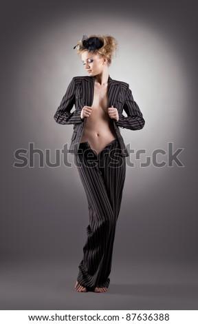 Pretty blonde woman portrait in black suit - stock photo
