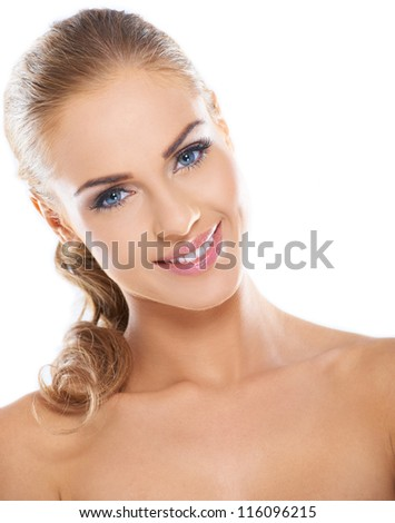 Pretty blonde woman posing while isolated on a bright background - stock photo