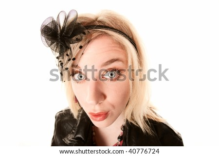 Pretty blonde woman with confused expression on her face