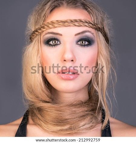 pretty blonde woman with elegance hair style and smoky eye make up - stock photo