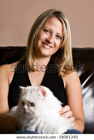 Pretty blonde woman with her pet cat.