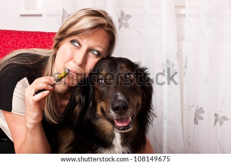 pretty blonde woman with mixed breed dog evaporated E Cigarette