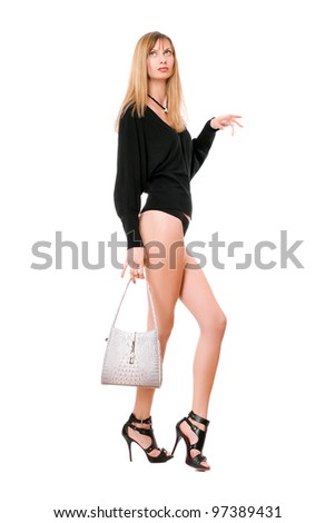 Pretty blonde woman with the white purse - stock photo
