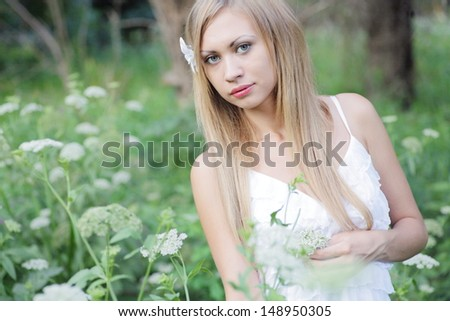 pretty blonde women outdoors in the meadow alone horizontal shot closeup - stock photo