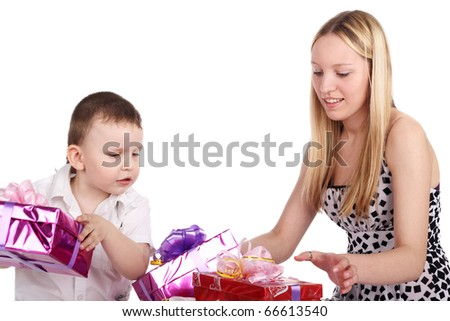 pretty blonde young girl and cute little boy with the gift boxes