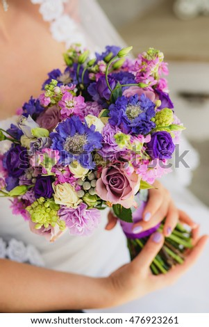 pretty bouquet in hands of the bride