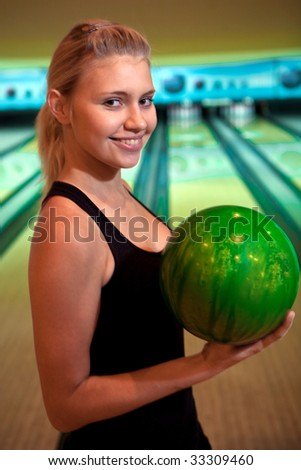 Pretty bowler with the green ball.