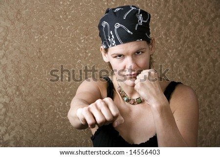 Pretty Boxing Woman Wearing a Bandanna on Her Head - stock photo